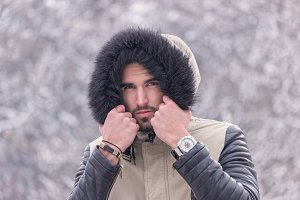 man cold winter outdoors head face