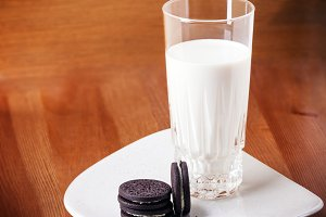 Milk and cookies on a wooden table