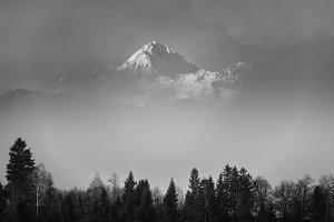 Misty mountain above the fog