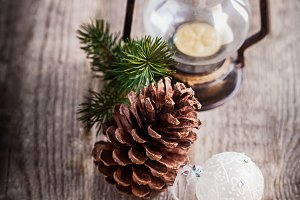 Christmas ornaments and old lamp on rustic wood