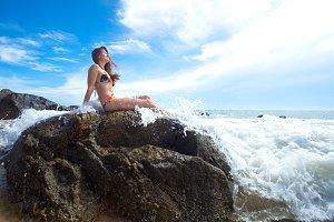 Beauty woman sitting on rock