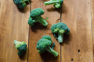 fresh organic broccoli on a wooden background