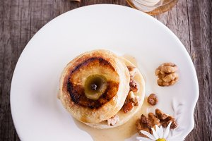 Baked apple with nuts and raisins