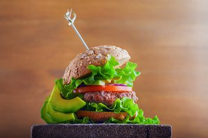 Delicious homemade burger on rustic wooden desk