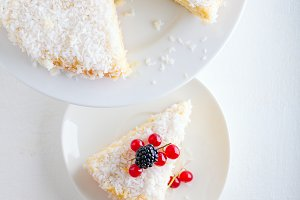 A piece of Homemade coconut cake on a white plate