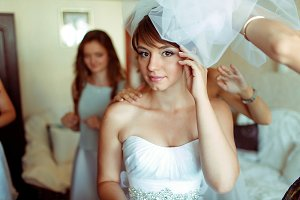Pretty bride stands thoughtful