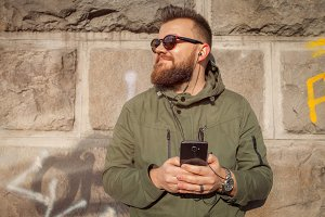 Hipster guy with smartphone