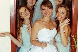 Bride and bridesmaids in the door