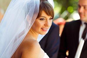 Shiny bride looks over her shoulder