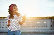 Pretty black girl in pink headphones