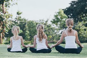 Mother and daughters doing yoga