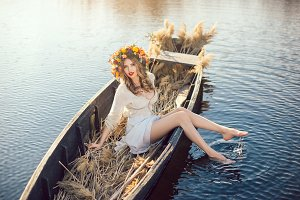 Fantasy art photo of a beautiful lady in boat