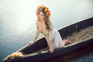 Fantasy art photo of a beautiful lady lying in boat