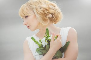 Young beautiful bride with a wedding bouquet.