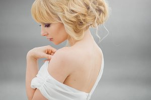 Portrait of romantic blond woman white dress