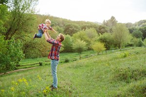 Cute little child playing outdoor with dad