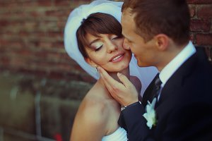 Bride smiles with closed eyes