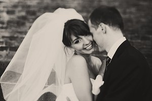 Bride smiles sparkling with groom