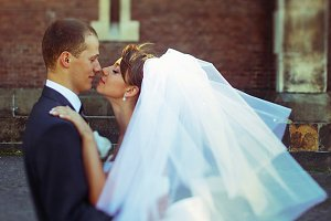 A moment before a kiss of newlyweds