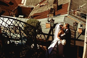 Wedding couple on an old roof