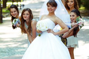 Bridesmaids behind a pretty bride