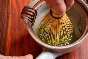 Stirring matcha tea