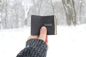 Winter idea. Vintage book with inscription on the background of snow