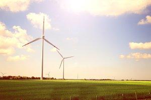 Windmills on field.