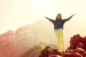 Girl feel freedom in mounatins.