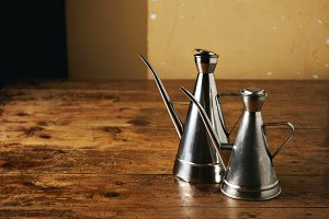 Stainless steel oil cruets