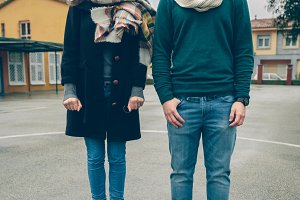 Portrait of couple wearing winter clothes standing outdoors