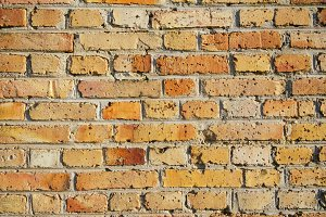 Background of old orange bricks in a wall