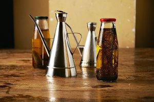 Olive oil with herbs and steel dispensers