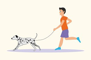 Man or boy with dog breed Dalmatian