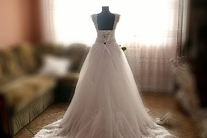 The wedding dress stands near room