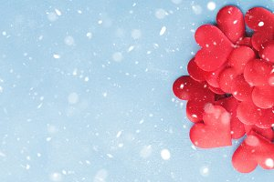 Valentines day banner background with red hearts. Snow