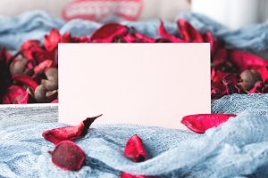 Blank paper note for Valentine's day and flower petals