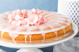 Bundt cake with frosting. Festive treat spring flowers