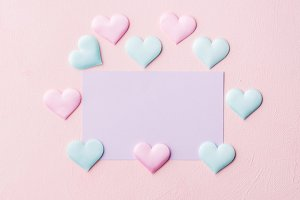 Purple pastel card and hearts on pink banner background