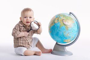 little funny boy with globe on white