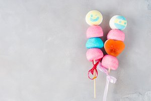 Colorful marshmallows cake pops male and female face