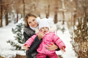 Mother and daughter. Winter gaiety
