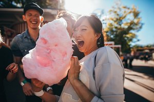 Young friends eating cotton candy