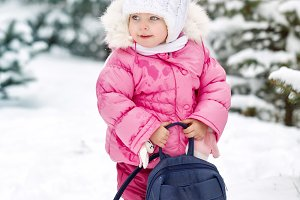 Little girl in the winter.