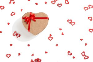 Gift heart with red ribbon