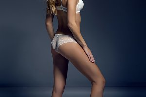 young blonde girl in white underwear