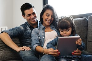 Happy family using tablet.