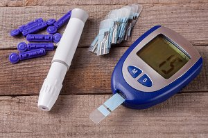 blood glucose meter on an old wooden background