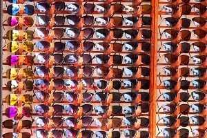 stand with many sunglasses on the market