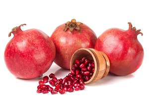 three pomegranate isolated on a white background